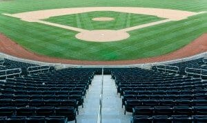 Baseball stadium with seating and a baseball diamond with green grass