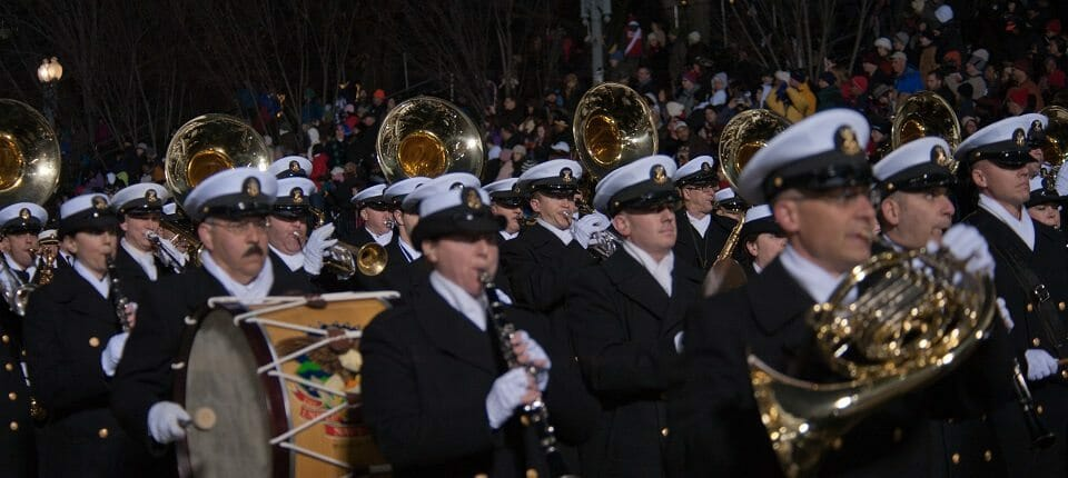 President Barack Obama watches the United States Navy Band from the presidential inauguration parade official review stand opposite Lafayette Park. The procession of more than 8,000 people that started at Constitution Avenue continued down Pennsylvania Avenue to the White House included ceremonial military regiments, citizen groups, marching bands and floats. The president, vice President, their spouses and special guests then review the parade as it passes in front of the presidential reviewing stand. The stadium-style stage is erected for the inauguration on the west front of the Capitol. It has more than 1,600 seats for members of Congress, Supreme Court justices, governors, foreign ambassadors, military leaders, Cabinet members, former presidents and the families of President Barack Obama and Vice President Joe Biden. The 57th Presidential Inauguration was held in Washington, on Monday, Jan. 21, 2013. The inauguration included the presidential swearing-in ceremony, inaugural address, inaugural parade and numerous inaugural balls and galas honoring the elected president of the United States. During the 10-day inaugural period, approximately 6,000 National Guard personnel from more than 30 states and territories worked for Joint Task Force-District of Columbia, providing traffic control, crowd management, transportation, communication, medical and logistical support as well as marching in the inaugural parade. More than 13,000 active duty, National Guard and Reserve military members were involved in the inauguration. The presidential inaugural parade included members from all branches of the armed forces of the United States. Since 1789, the U.S. armed forces have participated in this important American tradition honoring our commander in chief. The parade is organized by the Joint Task Force-National Capital Region, and participants are selected by the Presidential Inaugural Committee. (Official U.S. Air Force photo by Technical Sgt. Eric Miller/ New York Air National Guard)