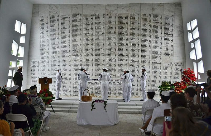 Sailors_fold_the_flag_during_ceremonies_for_the_interment_of_Seaman_1st_Class_Wallace_F._Quillin_at_the_USS_Arizona_Memorial_in_Pearl_Harbor,_Hawaii_121207-N-RI884-171