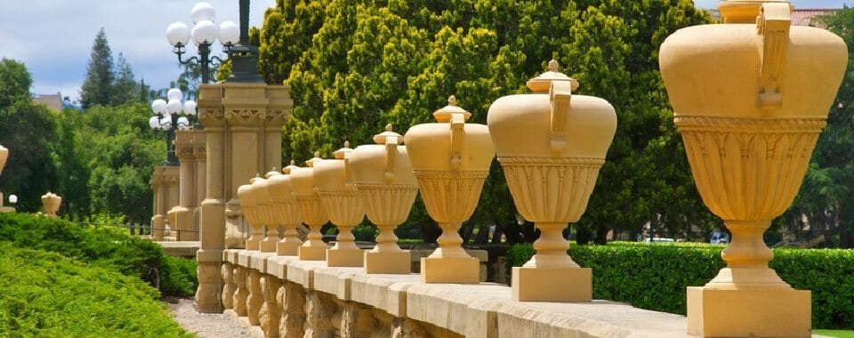 Row of tall urns sitting on railing at Stanford University