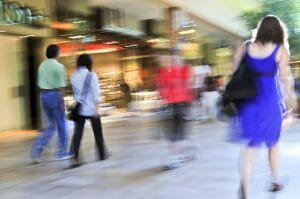 People shopping in a mall, panning shot, intentional in-camera motion blur